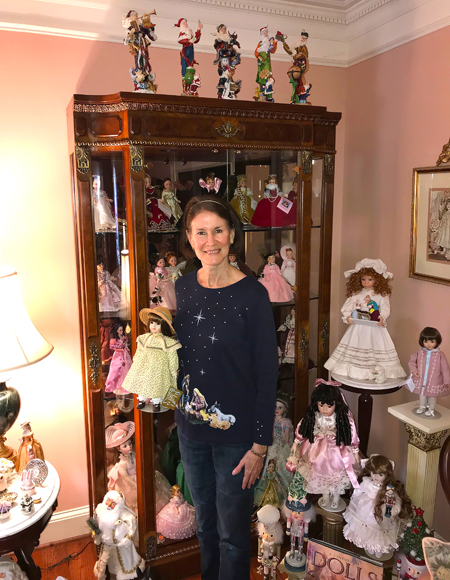 Mary Holcomb with dolls